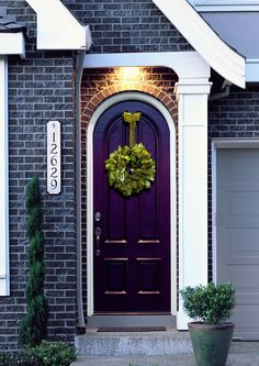 Eggplant coloured front door.. wondering if this would look good with the light grey brick of the new house..