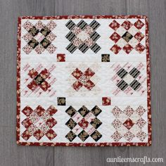 """Use my mini granny square tutorial to make your blocks, then assemble them into this granny square mini quilt. It measures less than 14 x 14""""!"""