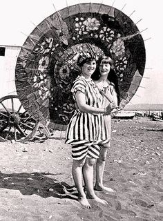 "Friends - Two young Edwardian women in ""bathing costumes,"" posing for the camera at the beach.  c 1910"