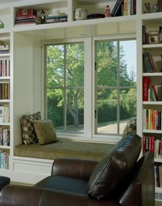 built-in bookshelves creating a nook for a window seat