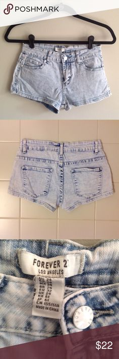Forever 21 denim shorts, size 24 Forever 21 Los Angeles light wash denim shorts with a subtle acid wash look. Size 24.  Color is closest to the third picture. More of a light blue than a light grey. Bundle 2 or more items to save! Forever 21 Shorts Jean Shorts