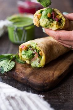 Introducing the Frankie! India's flavorful street food, also called a Mumbai Burrito. This vegan version is bursting with flavor- filled with curry mashed potatoes, roasted Indian cauliflower and chickpeas, fresh spinach, mint chutney and pickled onions.| www.feastingathome.com