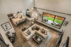 An open floor plan blurs the line between the living room, kitchen, and dining room at this Quadrant Homes property in Redmond, Washington.