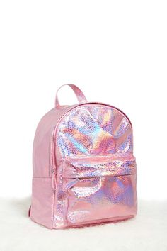 A pebbled faux leather backpack featuring a holographic design, two zipper compartments, an interior zipper pocket, two interior slip pockets, adjustable padded shoulder straps, and a top handle.