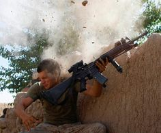 The War in Afghanistan : Sgt. William Olas Bee, a U. Marine from the Marine Expeditionary Unit, has a close call after Taliban jihadis opened fire near Garmsir in Helmand Province of Afghanistan, May 2008