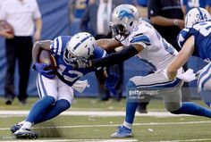 T.Y. Hilton #13 of the Indianapolis Colts is tackled by Darius Slay #23 of the Detroit Lions during the fourth quarter of the game between the Detroit Lions and the Indianapolis Colts at Lucas Oil Stadium on September 11, 2016 in Indianapolis, Indiana.