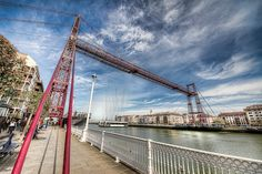 Vizcaya Bridge, Spain - not just another suspension bridge from the Industrial Revolution. This world's oldest transportation bridge managed to survive due to its innovative light twisted rope construction.