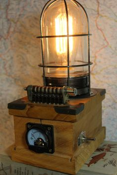 This is a unique steampunk inspired lamp made from new and used materials. The base is a wood cigar box made of aromatic cedar. It includes an edison style bulb. It is 110v powered and turns on with a toggle switch. Van Helsing could have used this light in his chambers to study the map of Draculas lair. Of course there are many other more normal uses. Such as lighting your own man or woman cave fot your own vampire hunts. Or not. It weighs about 3 lbs packed. It is 10 inches tall and 5…