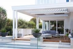 A new outdoor living area featuring overhead louvres and heaters is a key part of the extensive bungalow renovation by . Porches, Outdoor Living Areas, Outdoor Rooms, Bungalow Renovation, Bungalow Ideas, Alfresco Area, Hamptons House, Outdoor Entertaining, Old Houses