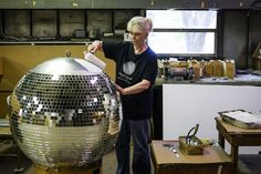 1. The Last disco ball maker in the U.S    Yolanda Baker, 69 years old, the last of the Omega crew still making the mirrored globes by hand.   At the height of the disco craze, about two dozen women joined Ms. Baker at the factory, often with the Bee Gees blaring from a tape player, as they tu