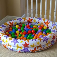 Ball Pit. This would be fun for a first birthday party. Get one of the bigger blow up pools when summer is close to ending so it is super cheap and fill the bottom with balls. The bigger pool would keep you from having as much come out all over the place and let more kids play.