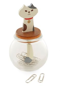 Meow You're Organized Paper Clip Holder | Been waiting to sort through your desk? Get on it right 'meow' with this adorable container! Fill this canister's round glass base with paper clips, then allow the magnetized tail of the wooden, calico kitty pick 'em up as you lift the lid!