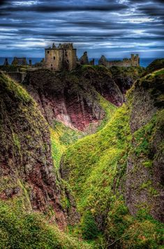 At the Dunottar Castle in Scotland. Beautiful tourist destination for sightseeing when traveling and going on road trips. Great castle for taking beautiful photography and planning on things to do in Scotland.