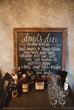 Surprise bourbon tasting bar for the groom at our wedding reception. We put this in one of our barn stalls at Overlook Barn and it was really popular!   l Michelle Lyerly Photography l CeCe Hampton Events l SJM Calligraphy l