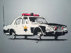 'Cop Car On Blocks' (2002) by Banksy.