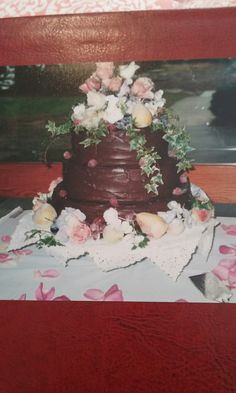 Chocolate ganache wedding cake with frosted fruits and flowers.homemade fudge layers.it was a hit.