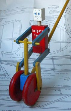 """""""Blockhead"""" cyclist stick push toy by Holgate. Details and mfr. date unknown. Uncommon. www.playfulplans.com Furniture Chairs, Garden Furniture, Kids Furniture, Furniture Plans, Bedroom Furniture, Outdoor Furniture, Best Toys, Kinetic Toys, Christmas Toys"""