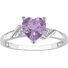 Miadora 10k White Gold Amethyst and Diamond Heart Ring has delicate detail work to make it extraordinary. A stunning heart-shaped amethyst is flanked by two uniquely shaped sparkling diamonds in this