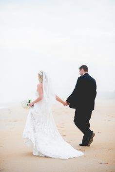 Gorgeous Ethereal Beach Wedding Portraits in the Mist | Captured by Belinda | See more! http://heyweddinglady.com/ethereal-beach-wedding-after-the-storm-from-captured-by-belinda/