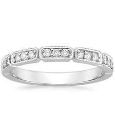 Deco Diamond Ring in 18K White Gold. 3 is my favorite and most lucky number. I live that this ring has diamonds in groups of three. And this site has a really good price on it. <$1k