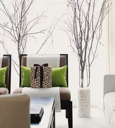 Look to your own backyard for these accessories! Place wintery bare branches in glass cylinders to achieve this look. More pretty Christmas living rooms: http://www.bhg.com/christmas/indoor-decorating/pretty-christmas-living-rooms/?socsrc=bhgpin112512naturallivingroom#page=24