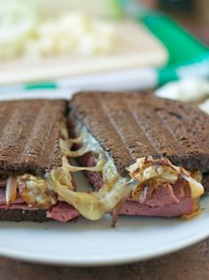 Corned Beef and Cabbage Grilled Cheese with Irish Cheddar. The ultimate St. Patrick's Day meal! - #recipe #stpatricksday
