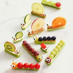 Celery Snails & Caterpillars Recipe: These adorable snacks take ants on a log to the next level. essen raupe 28 Easy After-School Snacks Your Kids Will Run Back Home to Eat Fruit Art Kids, Edible Crafts, Edible Food, Edible Art, Vegetable Carving, After School Snacks, Healthy Snacks For Kids, Kid Snacks, Eating Healthy