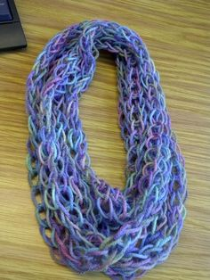Finger Knit Scarf - knit several feet, join into a circle, loop around your neck - voila! Finger Knit Scarf - knit several feet, join into a circle, loop around your neck - voila! Diy Finger Knitting, Finger Knitting Projects, Finger Crochet, Arm Knitting, Knit Or Crochet, Crochet Scarves, Crochet Projects, Knitting Patterns, Crochet Patterns