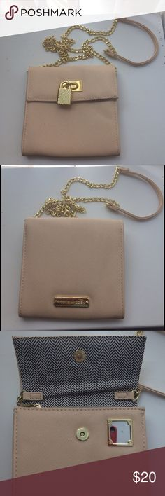 "Steve Madden Shoulder/Crossbody Bag Cute little bag by Steve Madden! Light nude pink color with gold chain. Lock detail on the front for decoration and mini mirror inside. Was used for prom, so it's in great condition! 3 sections inside, middle has copper closure to store valuables. Size: 6""x6"" with 23"" long strap. Steve Madden Bags Shoulder Bags"