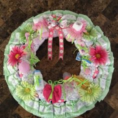 """Beatifully crafted diaper creations ranging from the original """"Diaper Cake"""" to specialty items which include bassinets, castles, bikes and more."""