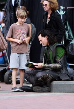 Mark Ruffalo's son looks so worried! Like Tom's going to steal his book! Don't worry, Tom only thinks he's Loki!