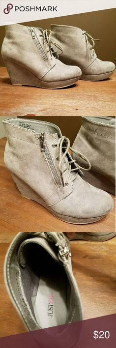 Grey Wedge Shooties Light grey, faux suede, wedge ankle boots. 3.25 inch heel with an inch platform. 7.25 inches from floor to top of boot. Zipper detail does unzip, but is really just for decoration, the shoelaces are meant to be used to take off and put on the boot. Worn once, in like new condition JustFab Shoes Ankle Boots & Booties