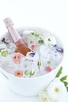 Some frozen flowers keep a bottle of prosecco or white wine cool.