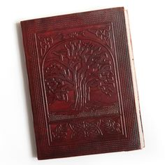 Keep your personal thoughts together in this gorgeous Tree of Life journal. This leather journal features 100beautiful  handmade pages of paper that are 100 percent environmentally friendly. This journal is practically a work of art.