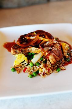 pineapple fried rice with asian pork chop - pioneer woman Pineapple Pork Chops, Pineapple Fried Rice, Pork Recipes, Asian Recipes, Cooking Recipes, Ethnic Recipes, Pork Meals, Freezer Meals, Rice Recipes