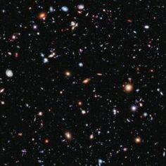 This long-exposure Hubble Space Telescope image of massive galaxy cluster Abell 2744 is the deepest ever made of any cluster of galaxies. It shows some of the faintest and youngest galaxies ever detected in space. Abell 2744, located in  the constellation Sculptor, appears in the foreground of this image. It contains several hundred galaxies as they looked 3.5 billion years ago.