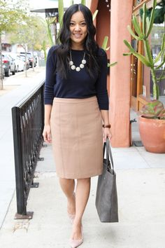 896e5394cc Business Casual Outfit: Navy Sweater + Tan Skirt + Grey Tote + Medallion  Necklace +