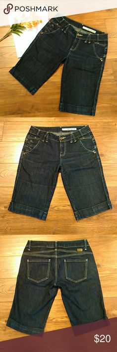 """DKNY Bermuda Jean Shorts Size 4 DKNY Mid Rise Bermuda  Cuffed Jean Shorts Size 4  5 Pockets Button with Zipper Closure  98% Cotton 2% Spandex  Aprox Measurements Taken Flat  Waist: 15.5""""(31) Rise: 8.25"""" Inseam: 12.5""""  In Pre-owned Condition With No Stains Or Holes  Please Check Out My Other Items  #66 DKNY Shorts Bermudas"""