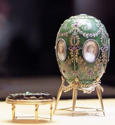 "The ""Alexander Palace Egg"" was created for Tsar Nicholas II in 1908. The egg is made of nephrite jade with gold, rose cut diamonds and rubies. Miniature watercolor portraits of the Tsar's children rest on each face of the egg. The surprise element, which is found in all of the Imperial Easter eggs, is a miniature of Alexander Palace made from enamel and gold with rock crystal windows. The egg was given to his wife, Empress Alexandra."