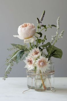This simple centerpiece, by Food 52's Art Director Alexis Anthony, is easy enough to DIY for a bridal shower or a casual outdoor wedding this spring. Simply tie bud vases together with twine and place three different types of flowers in each vessel.