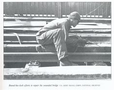 A U.S. Army engineer repairs the Ludendorff Bridge at Remagen during World War II.