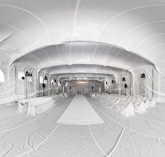 Massive plastic balloons inflate building interiors, by Barcelona-based art collective Penique Productions.