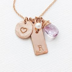 The Mother's heart charm necklace with baby's initial and birthstone is a pretty way to keep a reminder of your little one close, every day. The heart charm and initial rectangle tag are hammered for a modern, unique finish, and the wire wrapped birth stone is natural - no two are the same. New Mom charm necklace with baby's initial and birthstone, Mother's Day or Christmas personalized gift ideas for Wife. Alphabet Stamps, Family Necklace, Initial Necklace Gold, Hammered Gold, Personalized Jewelry, Heart Charm, Pink And Gold, Birthstones, Initials