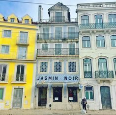 www.littlerugshop.com Lisbon's ubiquitous yellow & azulejo-clad tiled buildings with their wrought iron balconies are a thing of joy to observe and photograph  #lisbonlovers #azulejos #ihavethisthingwithtiles by budgettraveller