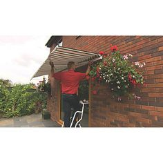 find this pin and more on garden ideas greenhurst patio awning terracotta 3 x - Garden Sheds 7 X 3