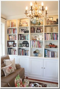 A bookshelf in a southern home.  It is decorated with just the right amount of books and other items to help create a warm feeling in the room.