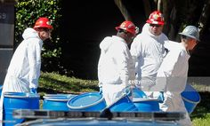 Hazmat workers with Protect Environmental unload barrels in preparation for decontaminating an apartment at The Village Bend East apartment complex where a second health care worker who has tested positive for the Ebola virus resides on October 15, 2014 in Dallas, Texas. Nurse Amber Vinson joins Nina Pham as health workers who have contracted the Ebola virus at Texas Heath Presbyterian Hospital while treating patient Thomas Eric Duncan, who has since died.