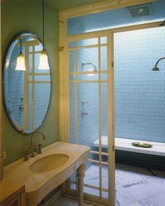 Steel shower doors with marble trim. www.gemmilldesign