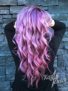 The perfect Pantone Radiant Orchid toned hair created with pinks and purples.