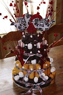 Wedding shower cake for a teacher.  Made with Hostess items from school's approved snack list.
